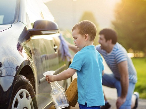 Father and Son Cleaning Car Outside