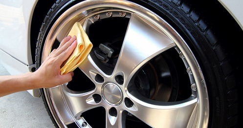 Detailing Tires with Yellow Rag