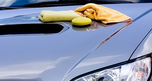 Cleaning the Car - waxing the hood
